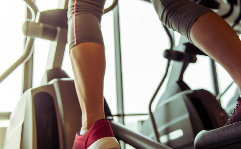 woman on elliptical machine in fitness center
